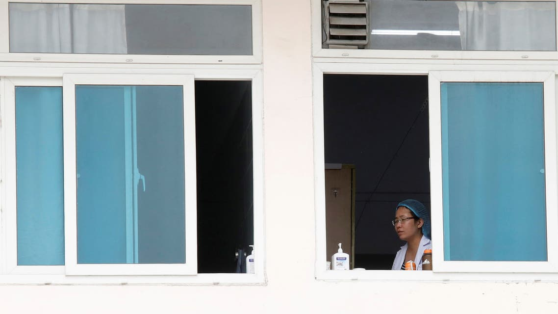 A health worker is seen at Vietnam's largest hospital, Bach Mai, where coronavirus cases have been detected in Hanoi, Vietnam March 26, 2020. REUTERS/Kham