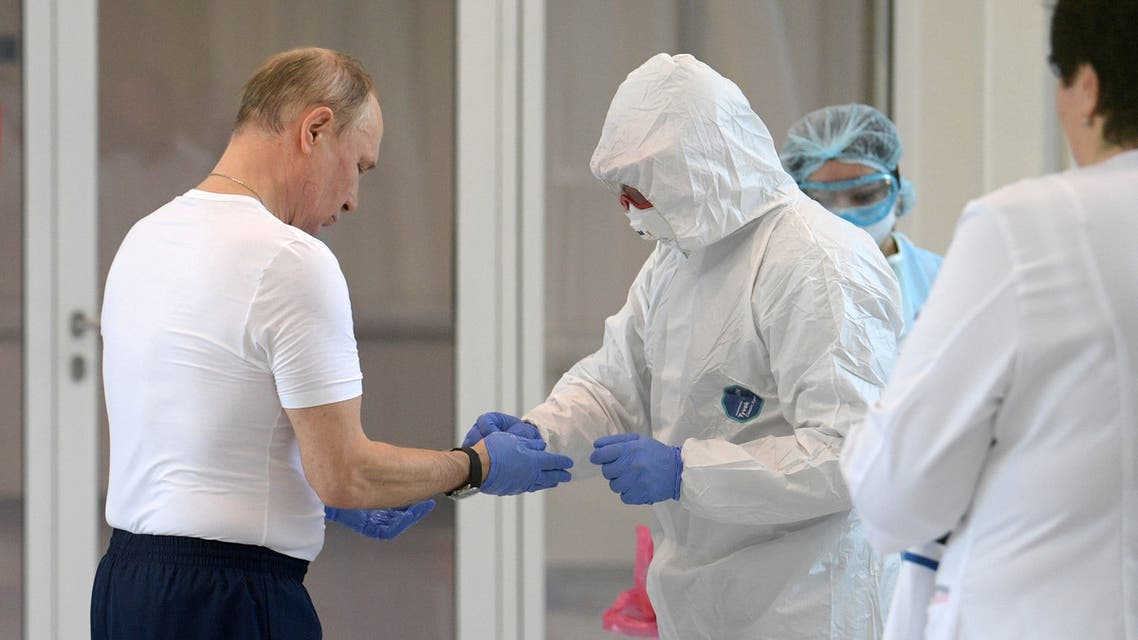 Russian President Vladimir Putin listens to Denis Protsenko, chief physician of a hospital for patients infected with coronavirus disease (COVID-19), as they walk at the hospital, on the outskirts of Moscow, Russia March 24, 2020. Sputnik/Alexey Druzhinin/Kremlin via REUTERS ATTENTION EDITORS - THIS IMAGE WAS PROVIDED BY A THIRD PARTY.