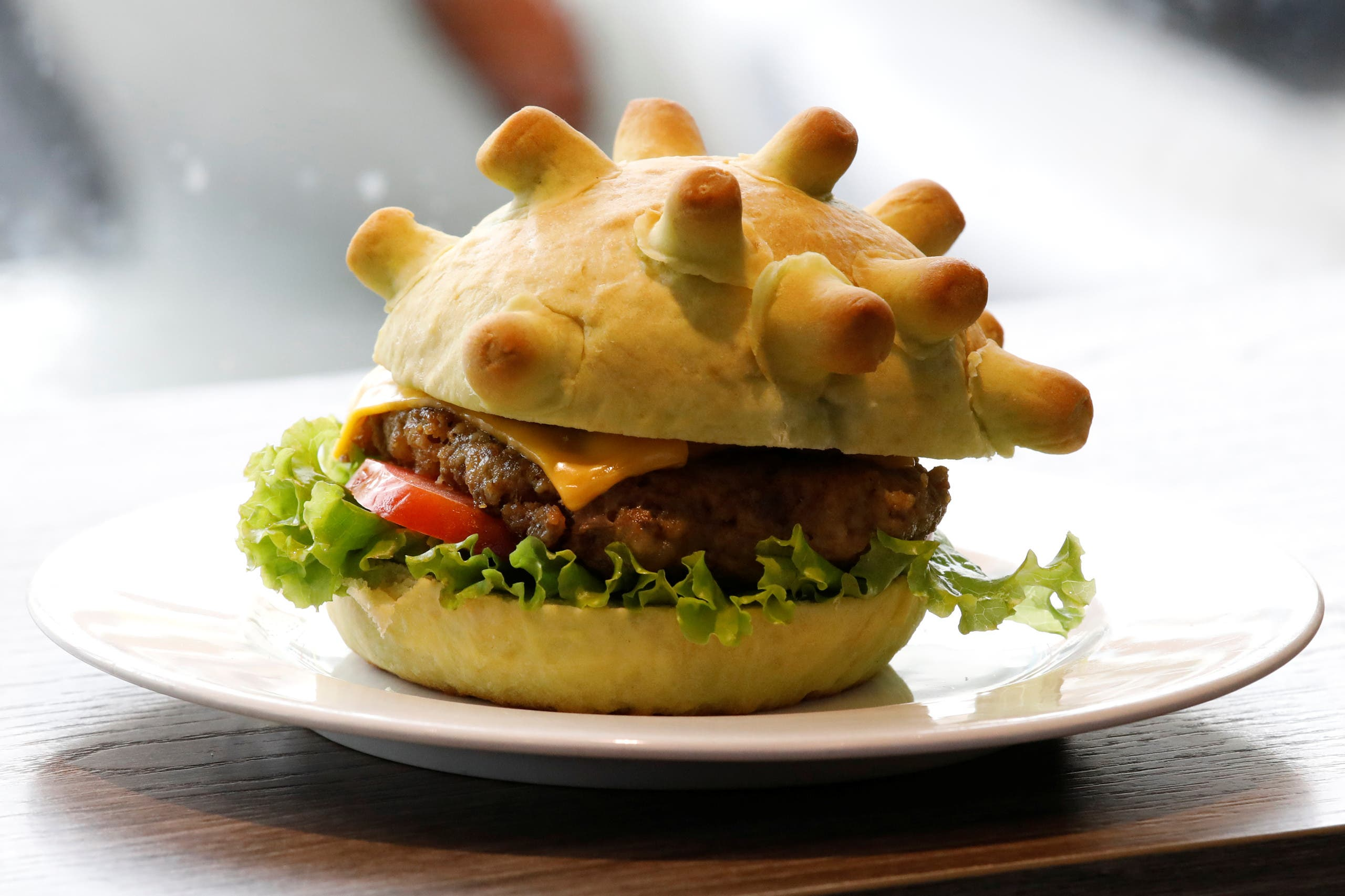 A burger shaped as coronavirus is seen at a restaurant in Hanoi, Vietnam March 25, 2020. (Reuters)