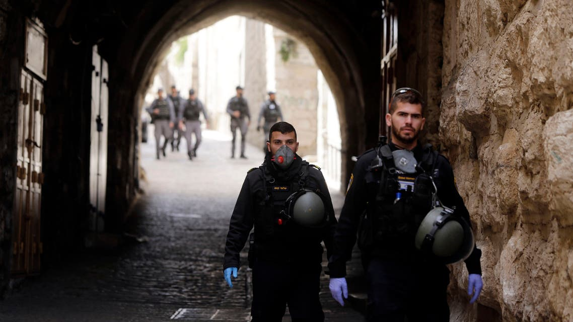 Israeli police patrol deserted street in Jerusalem's Old City, in Jerusalem on March 23, 2020. (AP)
