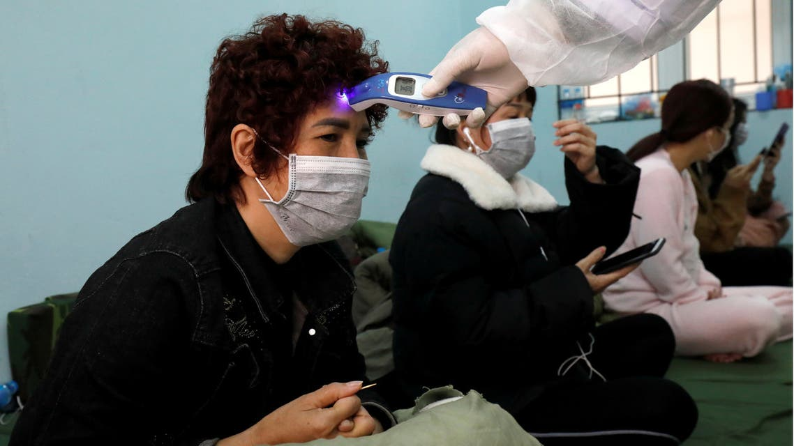FILE PHOTO: Military doctors check people, who came back from China, as they stay quarantined at a military base in Lang Son province, Vietnam February 20, 2020. REUTERS/Kham/File Photo