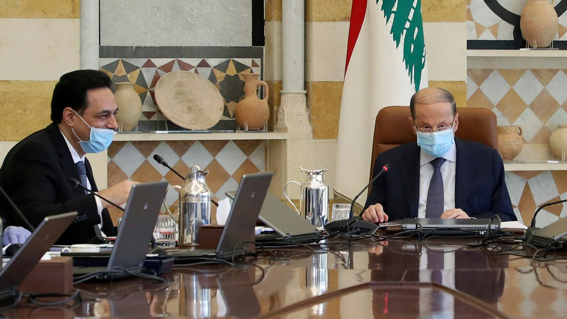 Lebanese President Michel Aoun, right, Prime Minister Hassan Diab, and government ministers wear masks to help protect themselves from the coronavirus, while attending a cabinet meeting at the presidential palace in Baabda on March 19, 2020. (AP)