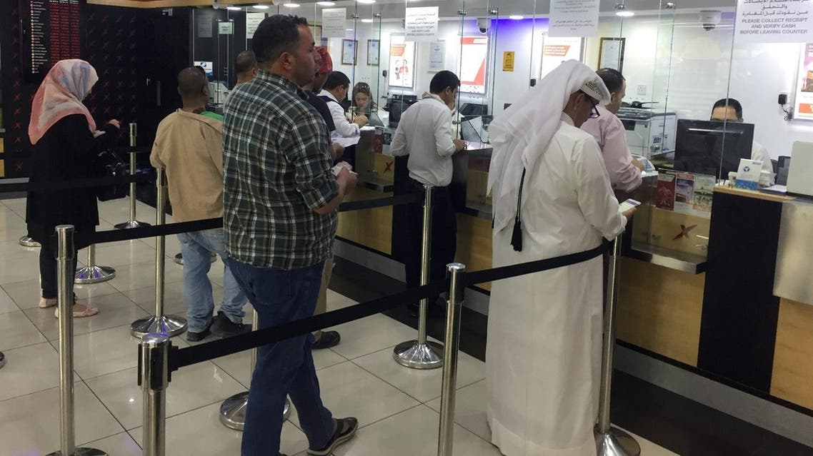 People exchange money at a money exchange office in Doha, Qatar, June 11, 2017. (File photo Reuters)