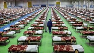 وفيات كورونا تلامس 2500 بإيران.. ومركز تجاري يتحول مستشفى