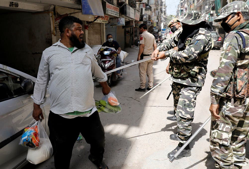 Police officers wield their batons against a man as a punishment for breaking the lockdown rules after India ordered a 21-day nationwide lockdown. (Reuters)