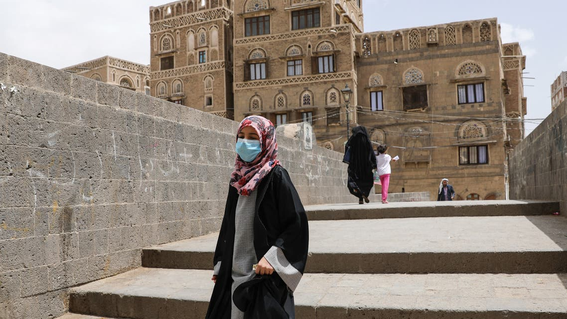 A girl wears a protective face mask amid fears of the spread of the coronavirus disease (COVID-19) in Sanaa (Reuters)