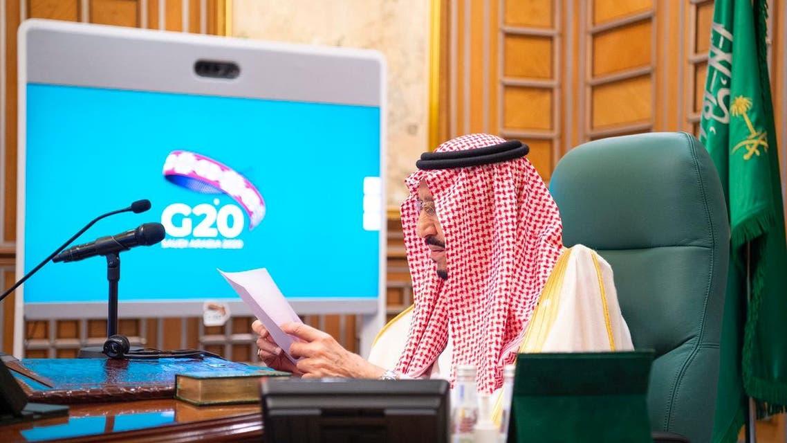 Saudi King Salman bin Abdulaziz attends via video link a virtual G20 summit on coronavirus disease (COVID-19), in Riyadh, Saudi Arabia March 26, 2020. Bandar Algaloud/Courtesy of Saudi Royal Court/Handout via REUTERS ATTENTION EDITORS - THIS PICTURE WAS PROVIDED BY A THIRD PARTY.