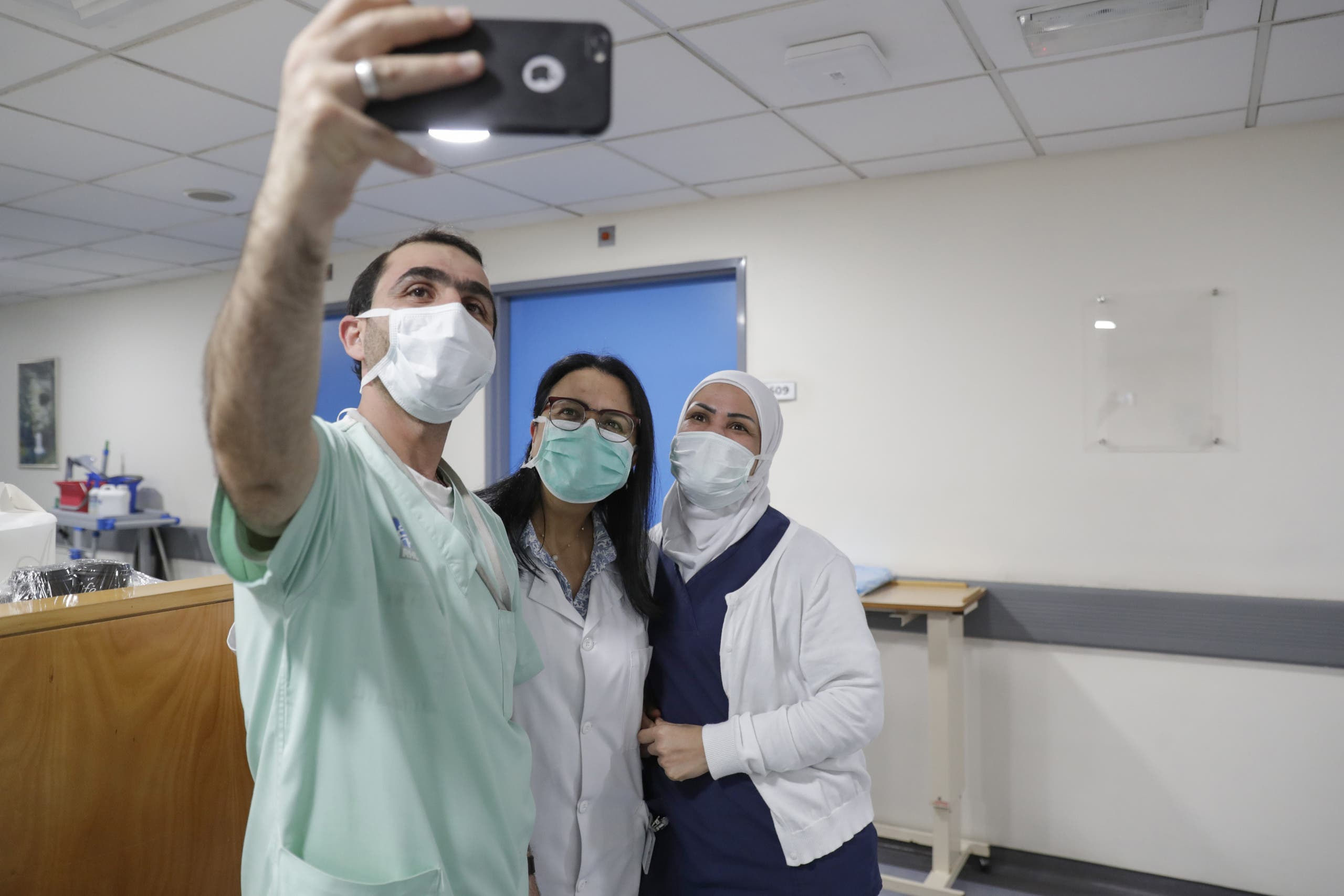 Staff members at Rafic Hariri University Hospital in Beirut, Lebanon, take a selfie amid coronavirus, February 21, 2020. (AFP)