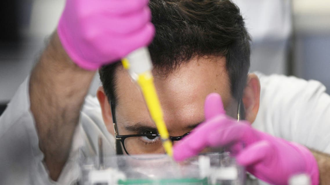 A researcher from the Institute of Biology at the Federal University of Rio de Janeiro (UFRJ) works to develop a new test capable of detecting in people with suspected of the coronavirus disease (COVID-19) in Rio de Janeiro, Brazil, March 25, 2020.