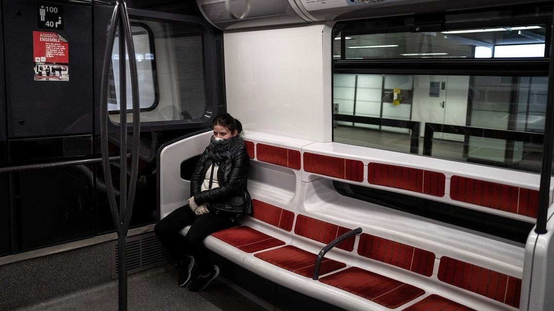 A woman sits on a metro car on March 20, 2020 in Lyon on the fourth day of a strict lockdown to stop the spread of COVID-19, caused by the novel coronavirus. (AFP)