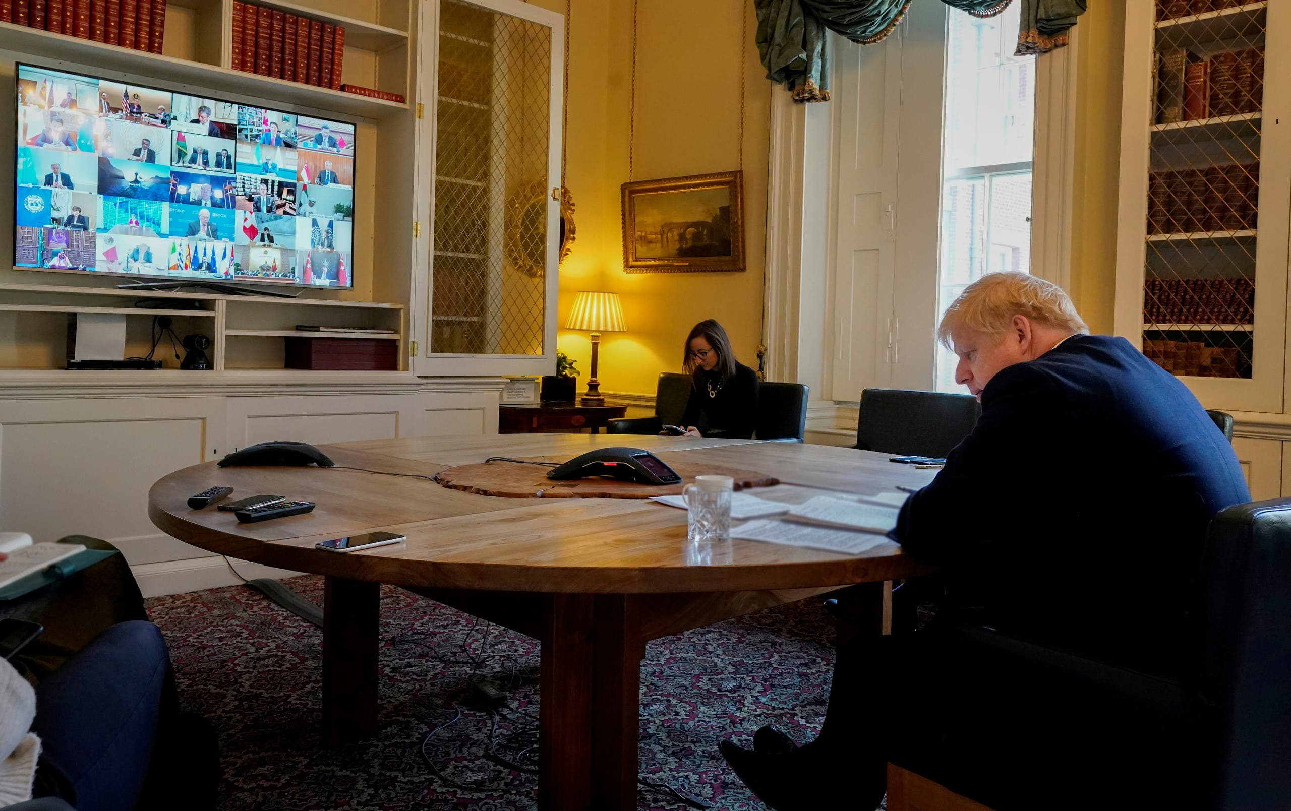 Britain's Prime Minister Boris Johnson sits in the study of 10 Downing Street, on a video conference call to other G20 leaders during the coronavirus outbreak in London, Britain. (File photo: Reuters)