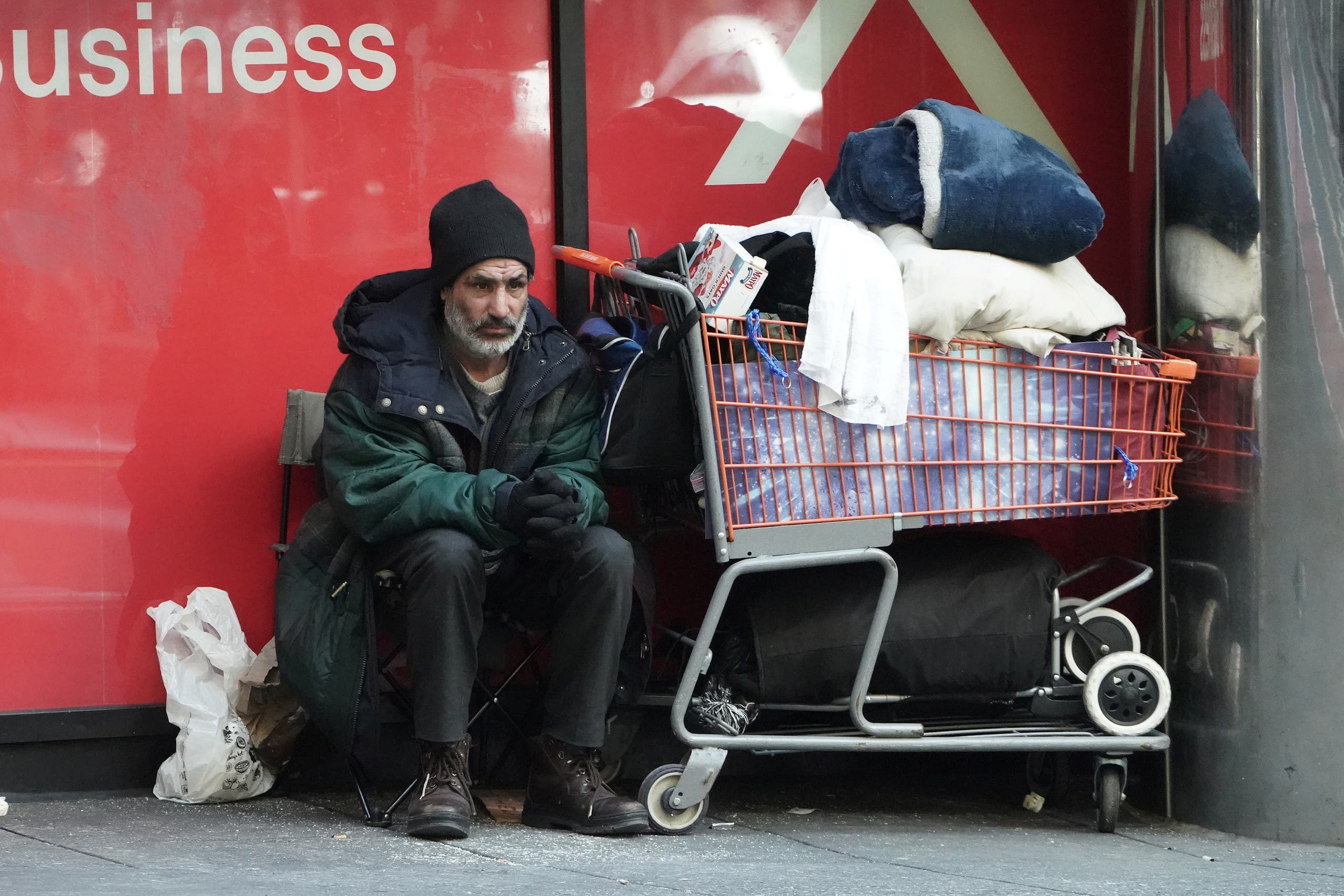 A homeless person sits with his belongings during the outbreak of Coronavirus disease, in the Manhattan borough of New York City on March 26, 2020. (Reuters)