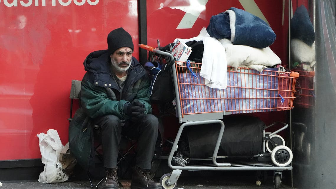 A homeless person sits with his belongings during the outbreak of Coronavirus disease (COVID-19), in the Manhattan borough of New York City, New York, U.S., March 26, 2020. REUTERS/Carlo Allegri