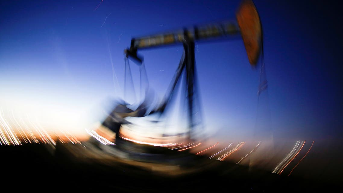 A long exposure image shows the movement of a crude oil pump jack in the Permian Basin in Loving County, Texas, US. (Reuters)