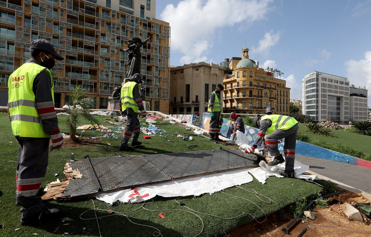 Workers clean the area around Martyrs' Square after Lebanese security forces cleared away a protest camp  in Beirut, Lebanon. (Reuters)