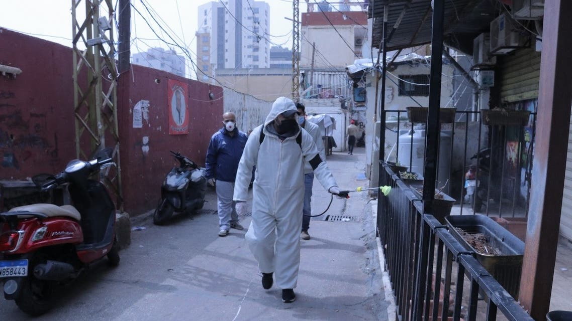 A man in a hazmat suit disinfects the Mar Elias Palestinian refugee camp in Beirut, Lebanon. (Ayham Alsahli.)