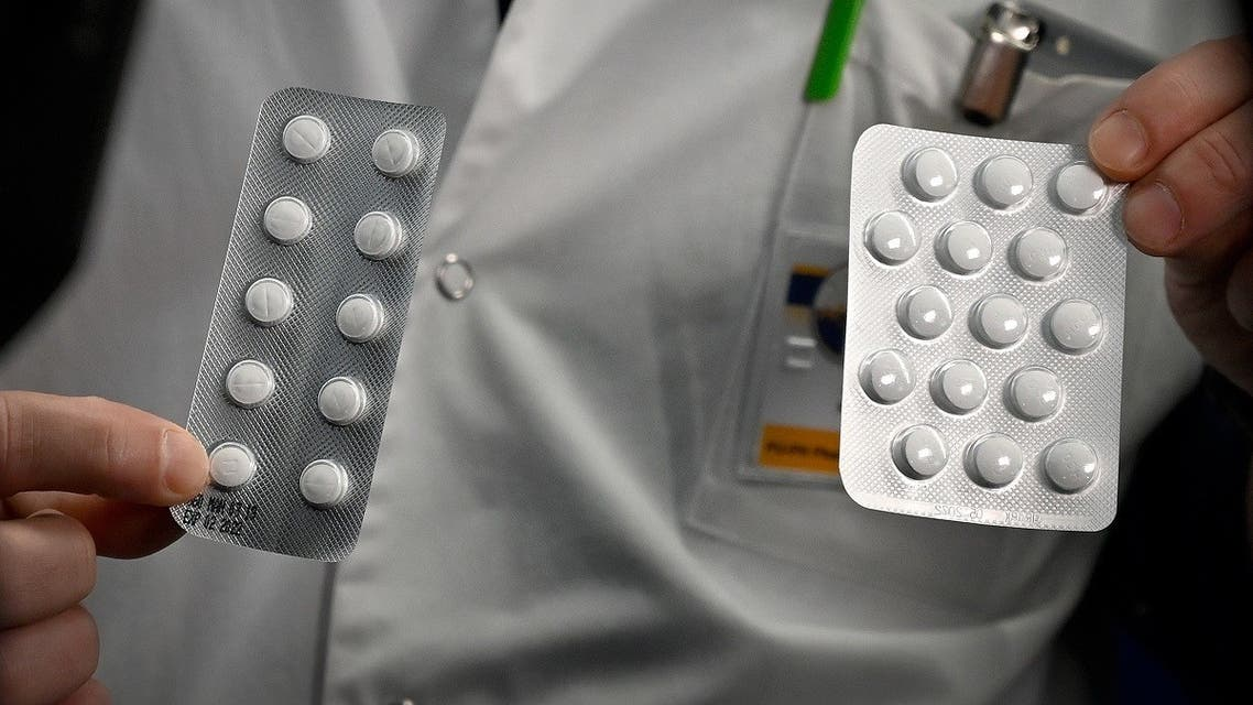 this file photo taken on February 26, 2020, medical staff shows o at the IHU Mediterranee Infection Institute in Marseille, packets of a Nivaquine, tablets containing chloroquine and Plaqueril, tablets containing hydroxychloroquine, drugs that has shown signs of effectiveness against coronavirus. (AFP)