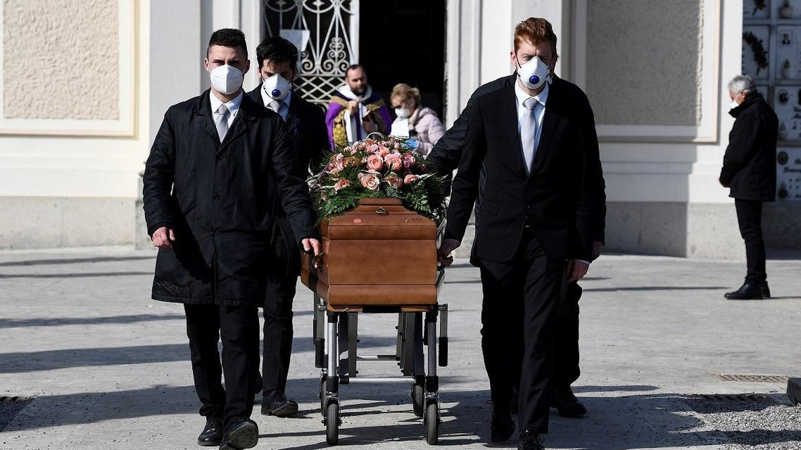Pallbearers wearing protective masks carry the coffin of a woman who died from coronavirus disease (COVID-19) at her funeral, as Italy struggles to contain the spread of coronavirus disease (COVID-19), in Seriate, Italy March 28, 2020. (Reuters)