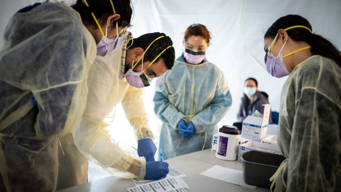 Doctors test hospital staff with flu-like symptoms for coronavirus (COVID-19) in set-up tents to triage possible COVID-19 patients. (AFP)
