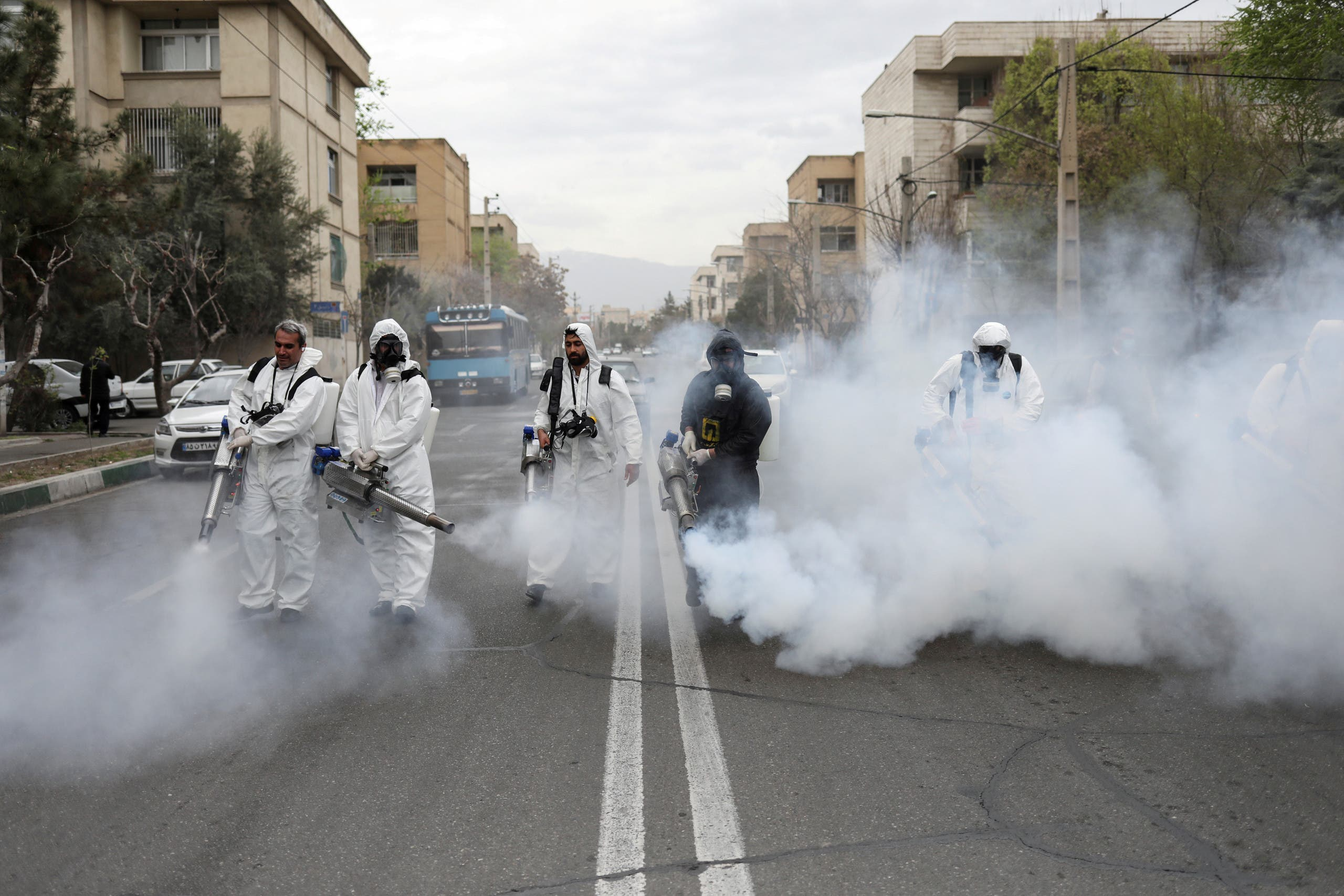 Firefighters wear protective face masks, amid fear of coronavirus, as they disinfect the streets, ahead of the Iranian New Year Nowruz, March 20, in Tehran, Iran. (File photo: WANA (West Asia News Agency)/Ali Khara via Reuters)