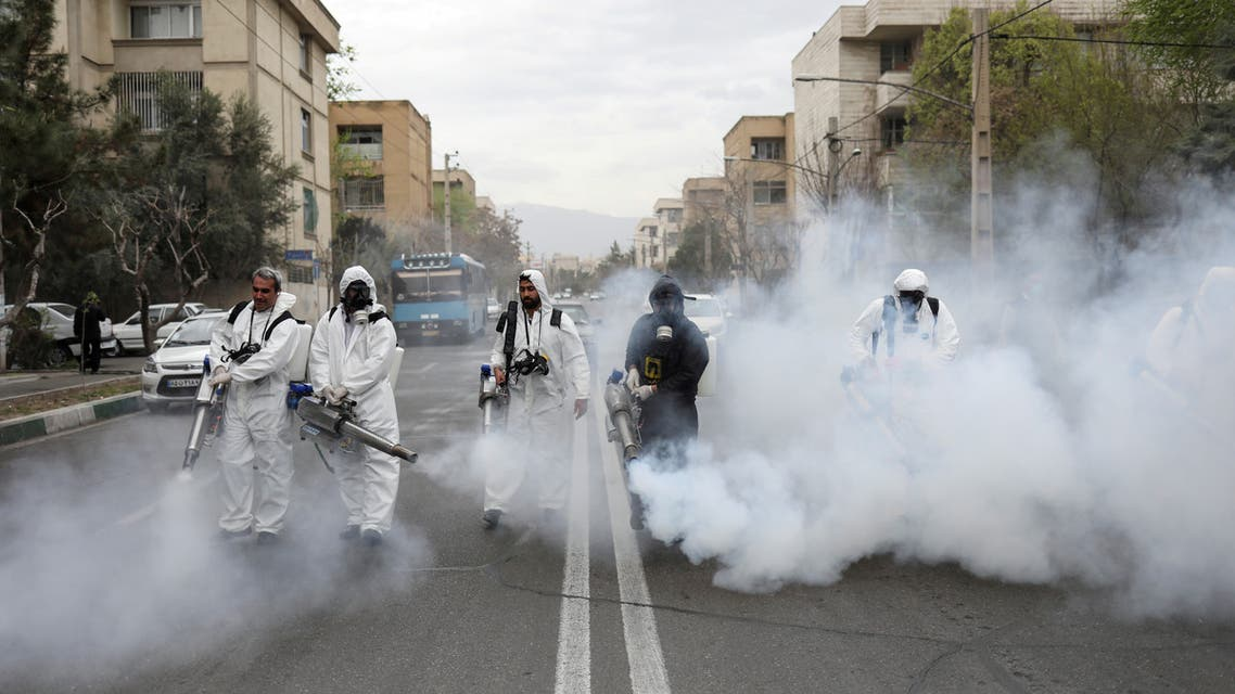 FILE PHOTO: Members of firefighters wear protective face masks, amid fear of coronavirus disease (COVID-19), as they disinfect the streets, ahead of the Iranian New Year Nowruz, March 20, in Tehran, Iran March 18, 2020. Picture taken March 18, 2020. WANA (West Asia News Agency)/Ali Khara via REUTERS ATTENTION EDITORS - THIS PICTURE WAS PROVIDED BY A THIRD PARTY/File Photo