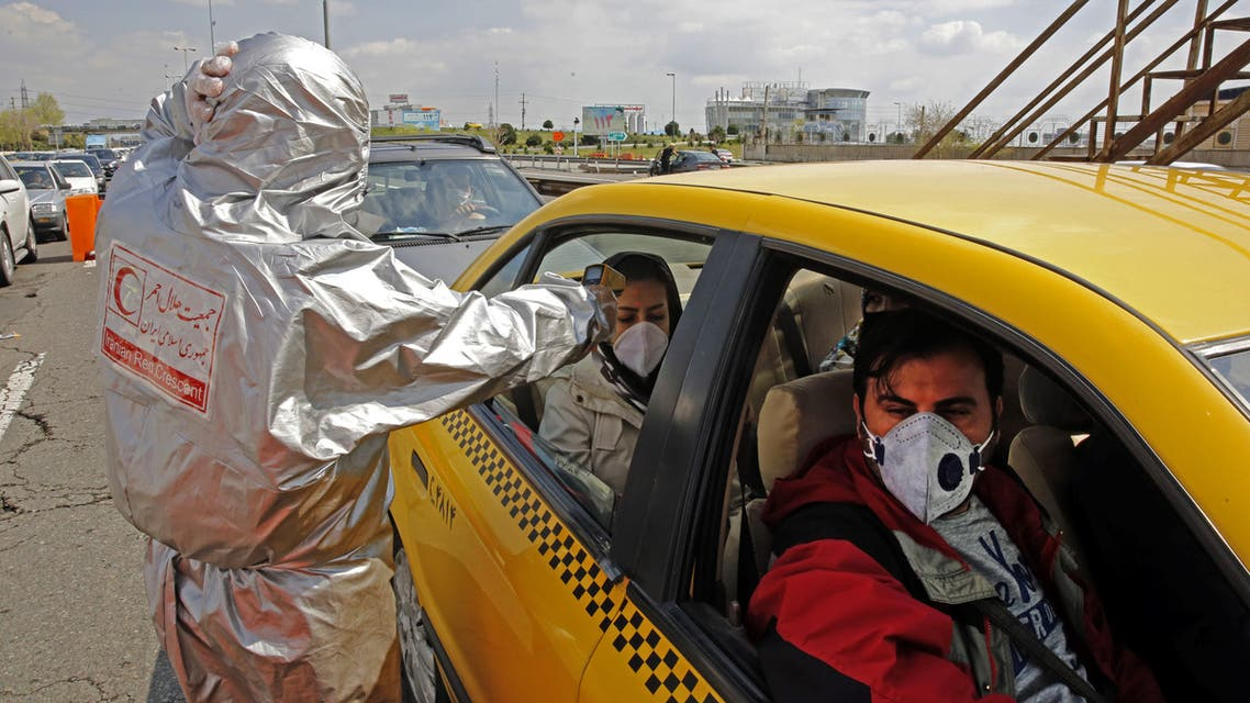 Members of the Iranian Red Crescent test people for coronavirus Covid-19 symptoms, as police blocked Tehran to Alborz highway to check every car following orders by the Iranian government, outside Tehran on March 26, 2020. Iran announced 157 new deaths from coronavirus, raising the official number of fatalities to 2,234, as it slapped a ban on intercity travel to try to curb the spread. Health ministry spokesman Kianoush Jahanpour also said that 2,389 new cases have been confirmed in the past 24 hours, bringing the total number of declared infections in one of the world's wost-hit countries to 29,406.