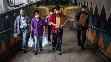 عين الصين على الوافدين.. قلق من موجة وباء ثانية