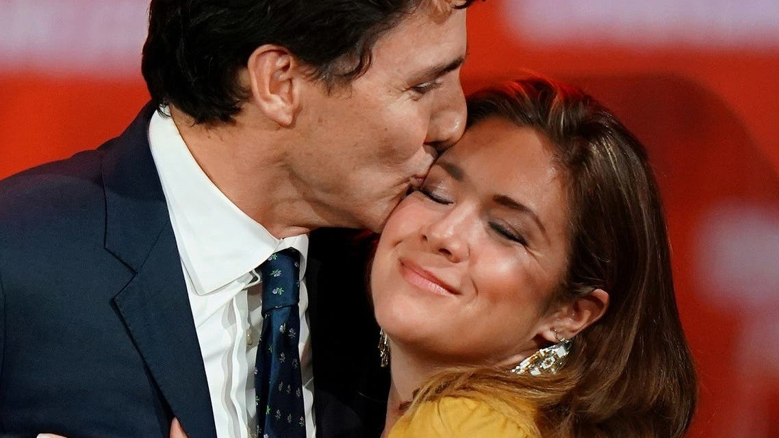 Canadian Prime Minister Justin Trudeau and his wife Sophie Gregoire Trudeau hug on stage after the federal election at the Palais des Congres in Montreal. (Reuters)