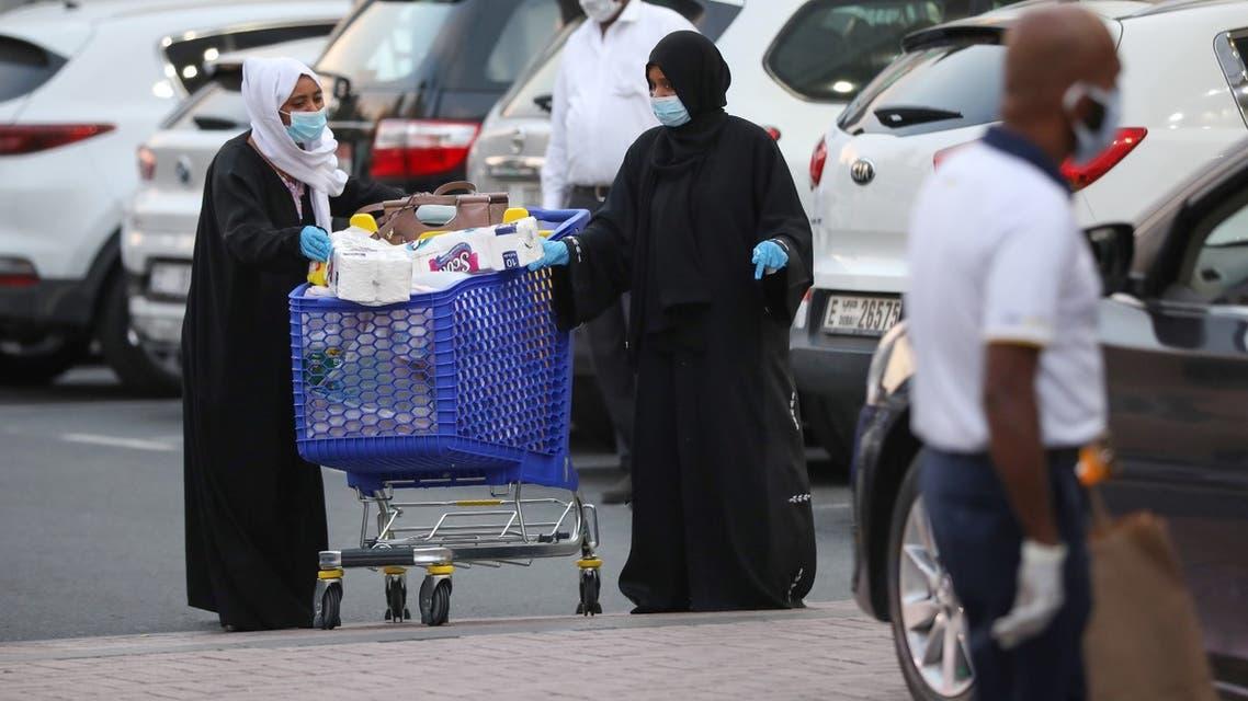 Women leave a supermarket, following the outbreak of the coronavirus disease (COVID-19), in Dubai, United Arab Emirates, March 26, 2020. (Reuters)