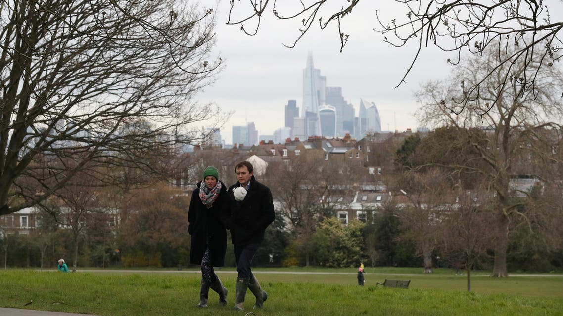 People walk in Brockwell Park, as the spread of the coronavirus disease (COVID-19) continues, London, Britain, March 30, 2020. (Reuters)