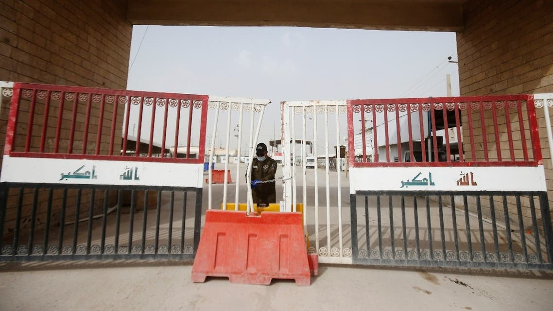 A member of Iraqi Border Guards is seen at the gate of Shalamcha Border Crossing, after Iraq shut a border crossing to travelers between Iraq and Iran, March 8, 2020. (Reuters)