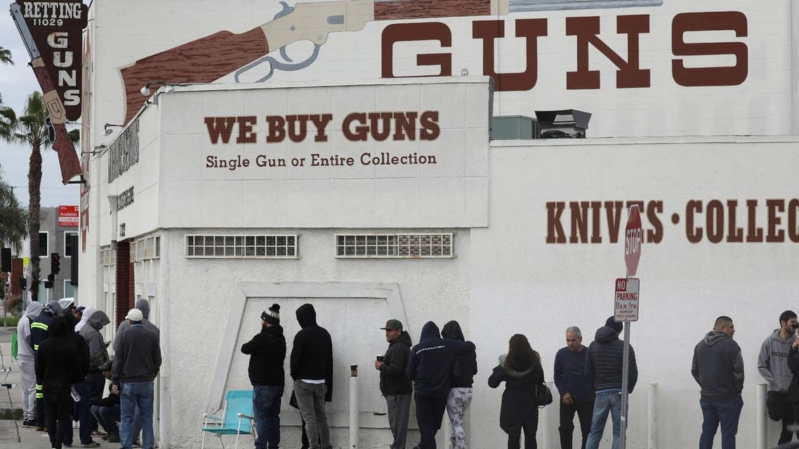 People wait in line outside to buy supplies at the Martin B. Retting, Inc. gun store amid fears of the global growth of coronavirus cases, in Culver City, California, US, March 15, 2020. (Reuters)