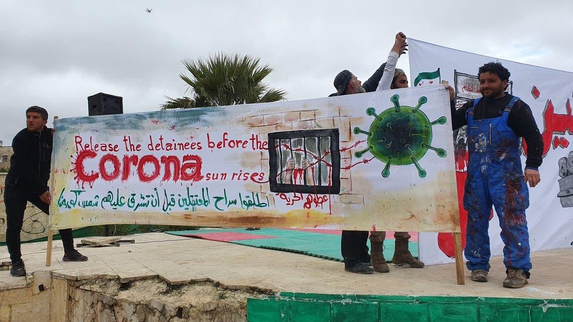 Syrian artist paints coronavirus murals in Idlib. (Mohammed Jamalo)