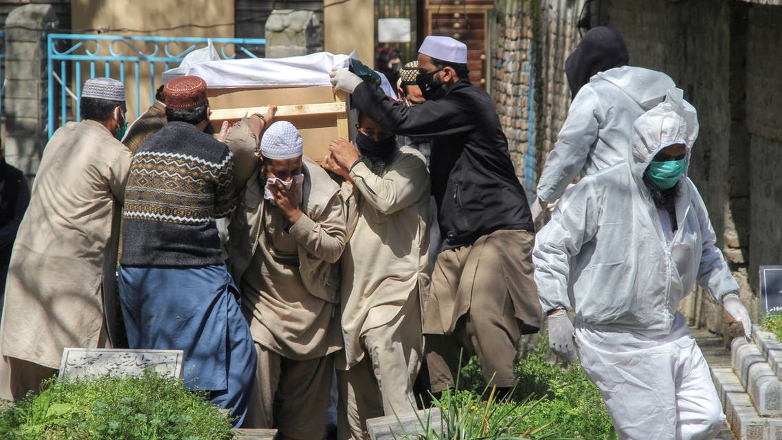 People move a coffin of a man who died due to coronavirus disease (COVID-19), for a burial at graveyard in Abbottabad, Pakistan March 29, 2020. (Reuters)
