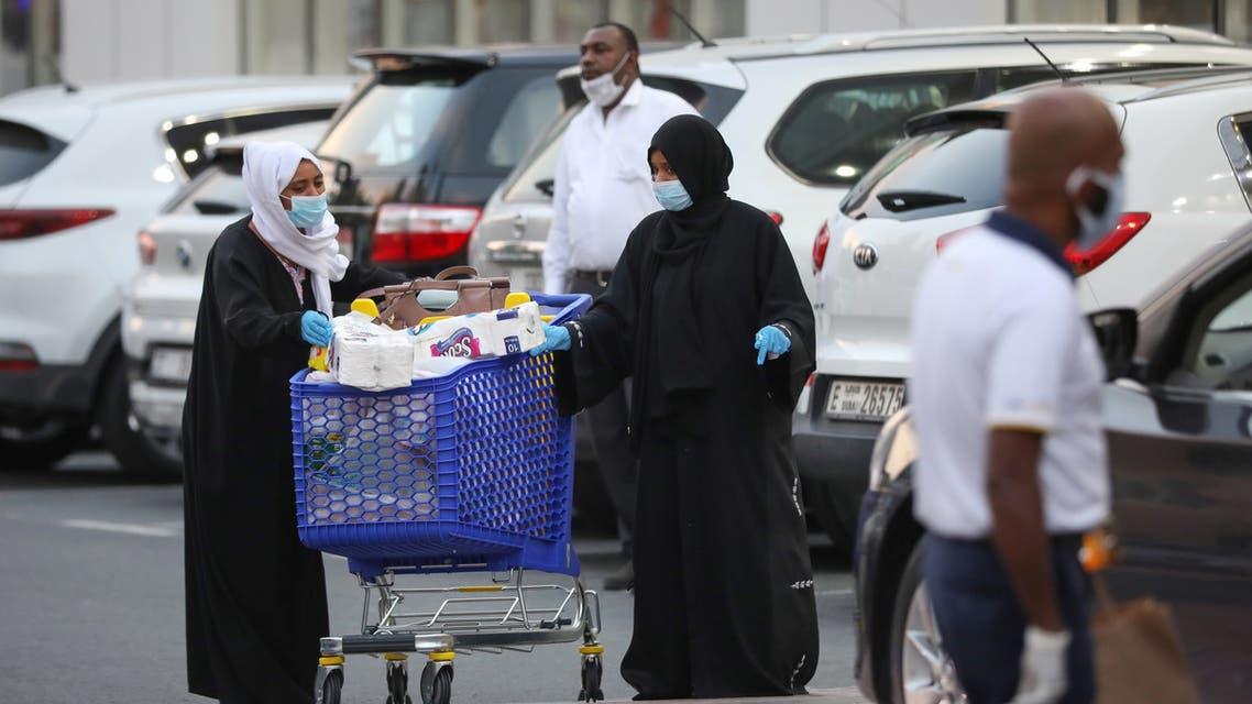 Women leave a supermarket, following the outbreak of the coronavirus disease (COVID-19), in Dubai. (Reuters)
