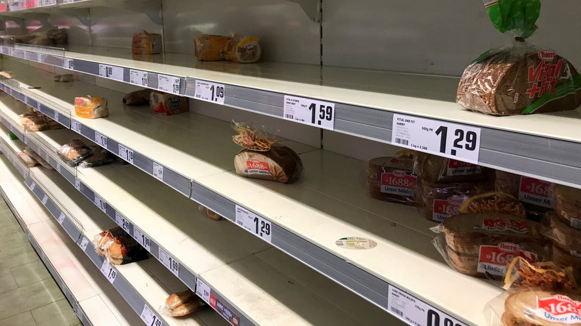 Empty shelves with remaining bread are pictured in Berlin, Germany March 14, 2020. (Reuters)