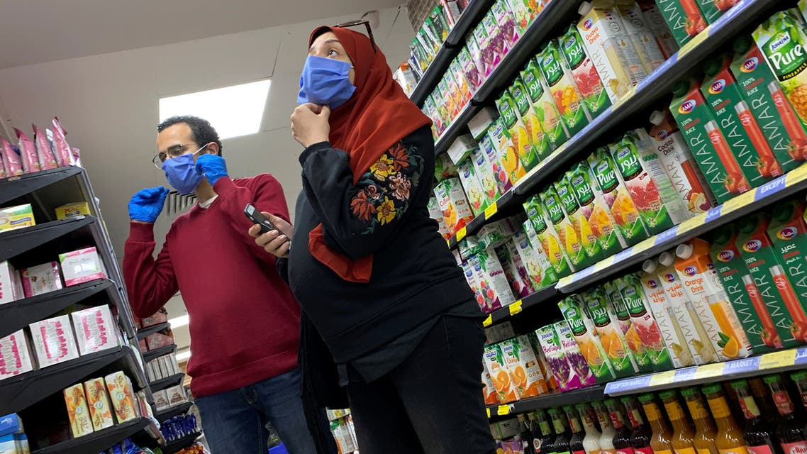 A family with protective masks is seen at a market before the start of night-time curfew to contain the spread of the coronavirus disease (COVID-19) in Cairo, Egypt March 29, 2020. REUTERS/Amr Abdallah Dalsh