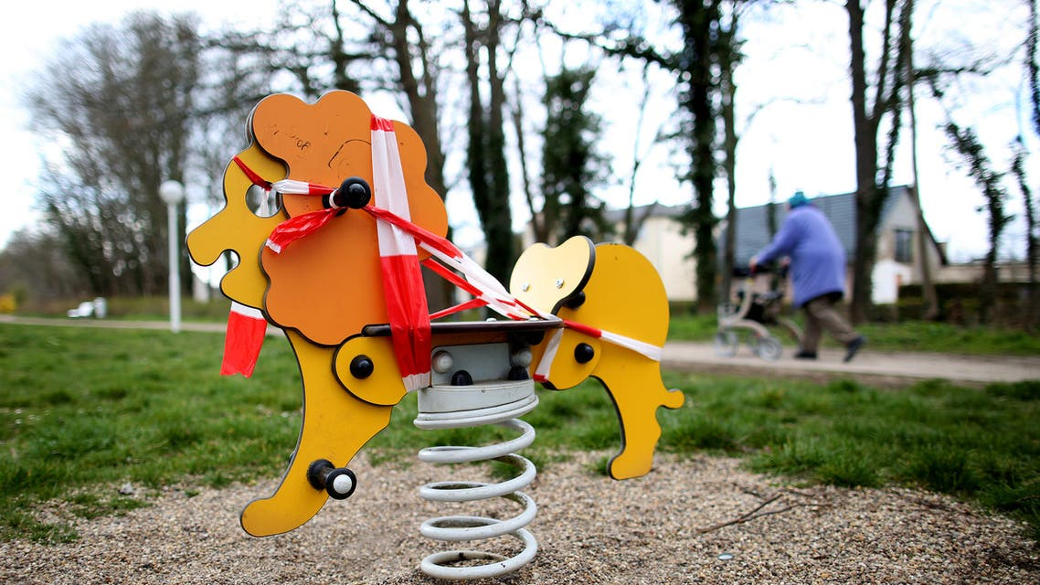 Barrier tape markes the access to a swing is blocked in a closed children's playground in Schoenebeck near Magdeburg, eastern Germany, where schools are closed and other activities slowed down due to the coronavirus COVID-19 crisis, on March 31, 2020.