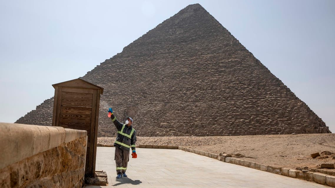 Municipal workers sanitize the areas surrounding the Giza pyramids complex in hopes of curbing the coronavirus outbreak in Egypt, Wednesday, March 25, 2020. (AP)