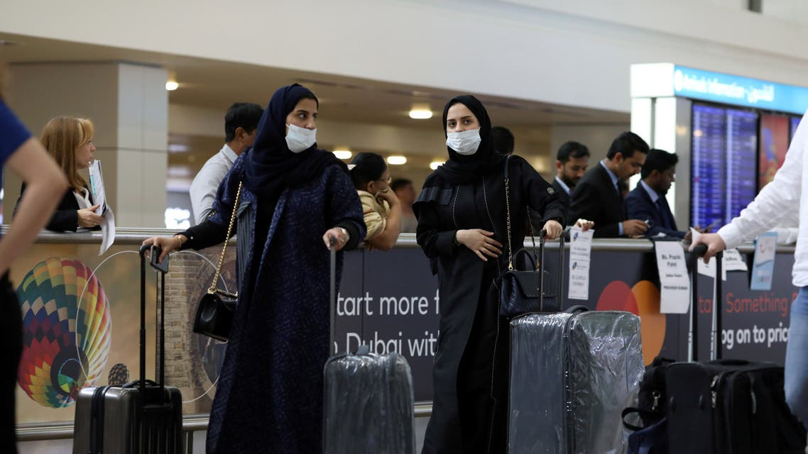 Travellers wear masks as they arrive at the Dubai International Airport, January 29. (Reuters)