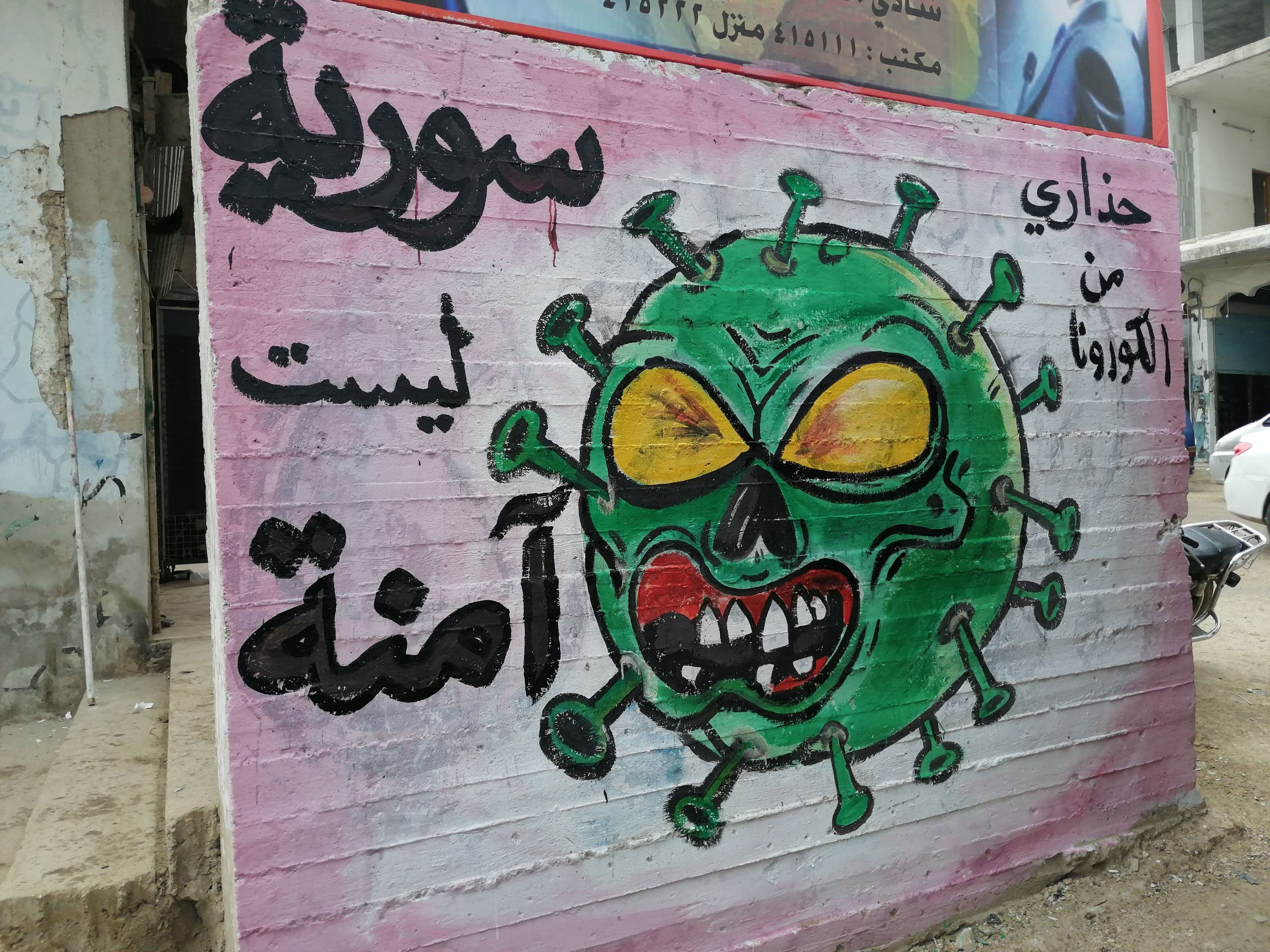 "A mural which reads ""Syria isn't safe"" in Idlib by Aziz Asmar. (Mohamad Jamalo)"