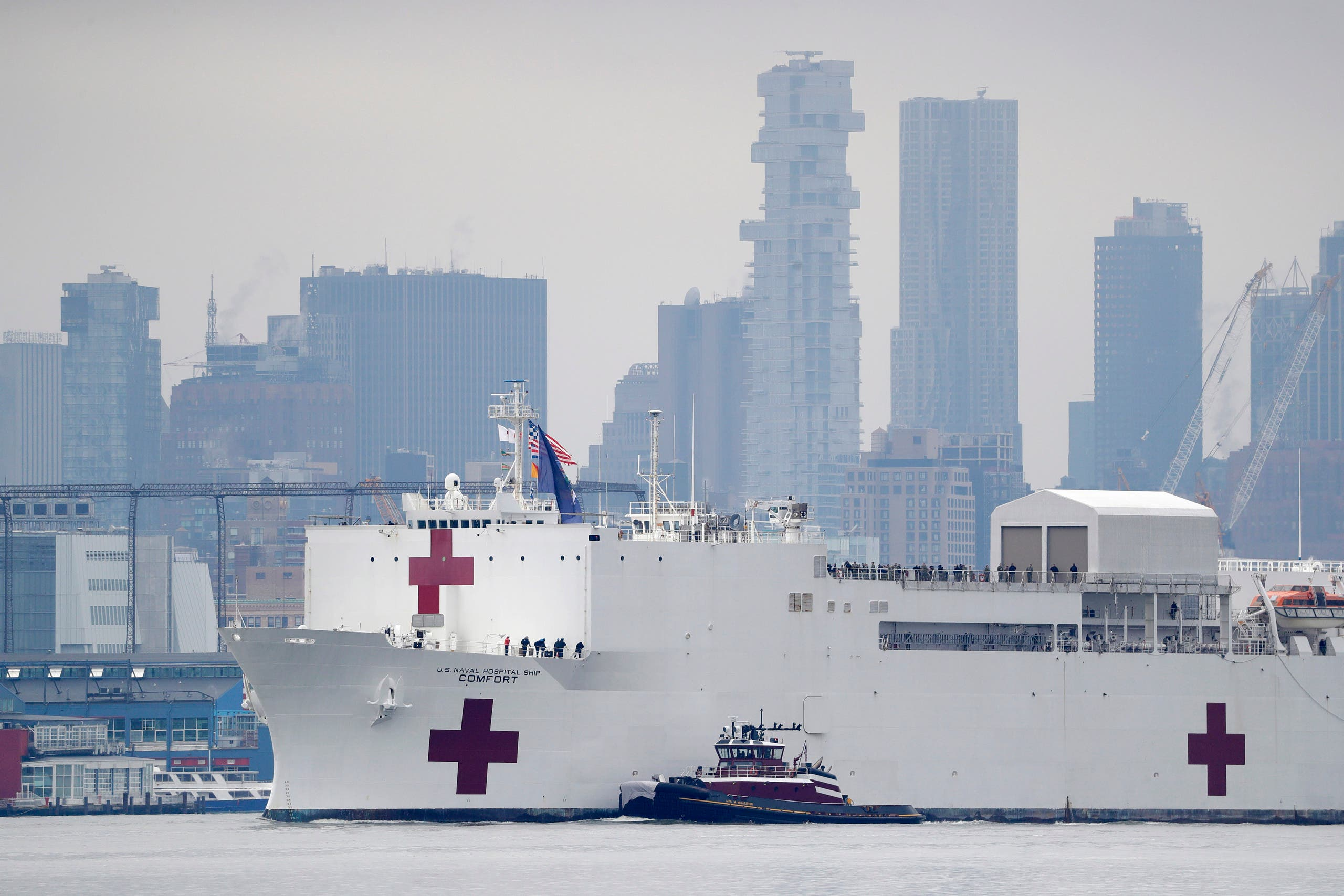 The Navy hospital ship USNS Comfort passes lower Manhattan on its way to docking in New York on March 30, 2020. (AP)