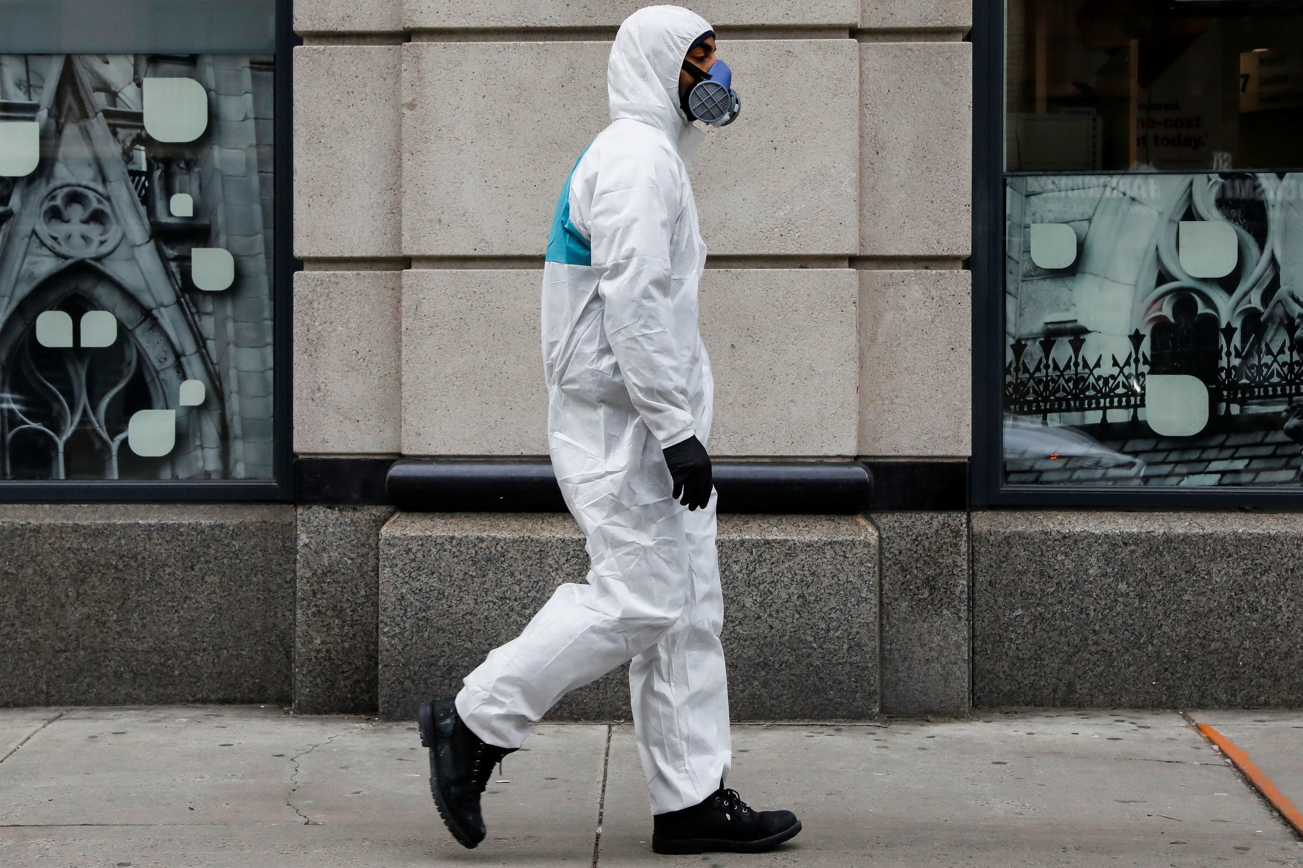 A man wears personal protective equipment (PPE) as he walks on First Avenue, during the coronavirus disease (COVID-19) outbreak, in New York City, U.S., March 31, 2020. (Reuters)