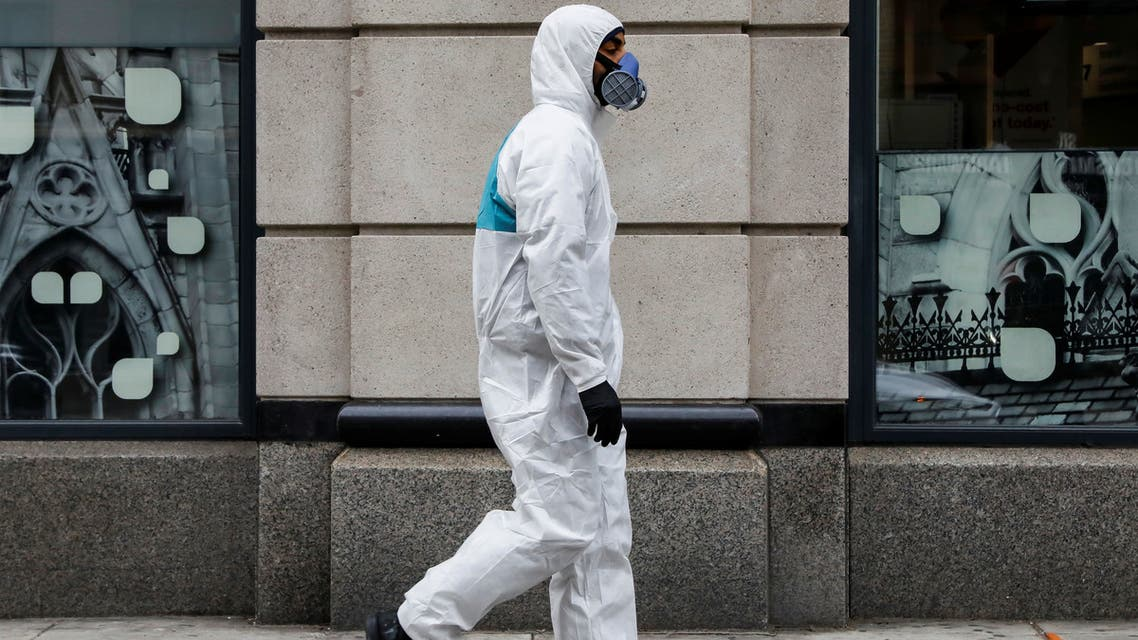 A man wears personal protective equipment (PPE) as he walks on First Avenue, during the coronavirus disease (COVID-19) outbreak, in New York City, U.S., March 31, 2020. REUTERS/Brendan McDermid