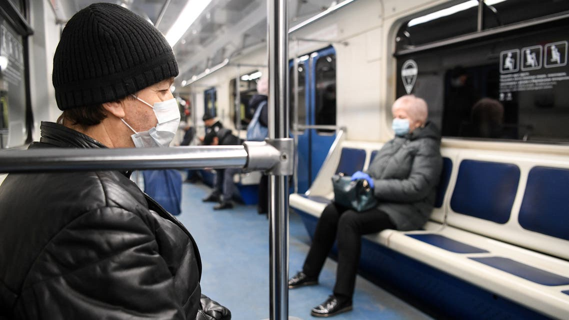 A man wearing a protective face mask sits in the Moscow subway car in Moscow on March 31, 2020, amid the spread of the COVID-19 coronavirus. The mayor of Moscow on March 30, 2020 told older Russians to either stay at home or escape to their country houses to avoid exposure to the COVID-19. Moscow, with its more than 12 million people, went into lockdown on March 30, 2020 and more than a dozen regions moved to introduce similar steps to curb the coronavirus outbreak.