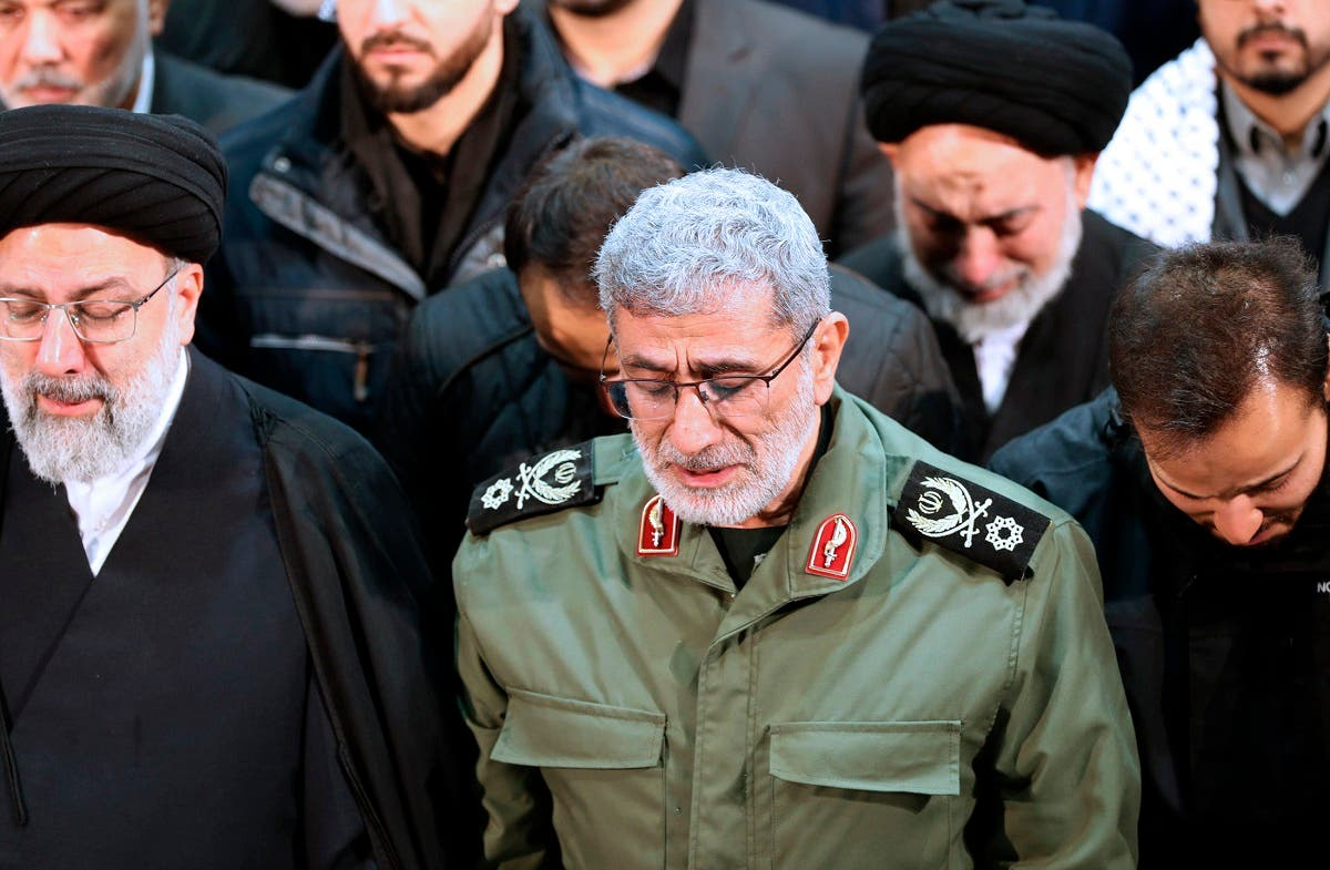 In this photo released by the official website of the Office of the Iranian Supreme Leader, Gen. Esmail Ghaani, newly appointed commander of Iran's Revolutionary Guards Quds Force, weeps while praying over the coffin of the force's previous head Gen. Qassem Soleimani at the Tehran University Campus in Tehran, Iran. (AP)