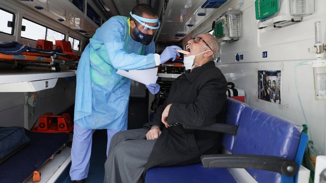 A man is treated by a Jordanian doctor as part of initiative that was launched with the aim of providing Jordanians with field medical services, amid concerns over the spread of the coronavirus disease (COVID-19), in Amman, Jordan, March 30, 2020. (Reuters)