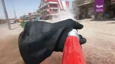 Coronavirus: Iraqi riot police use water cannons to disinfect streets of Basra