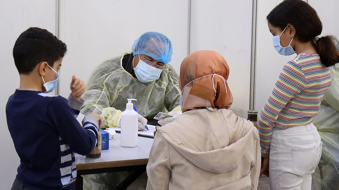 Expatriate returning from Egypt, Syria, and Lebanon arrive to be re-tested at a Kuwaiti health ministry containment and screening zone for COVID-19 coronavirus disease in Kuwait City on March 16, 2020. Facing a mounting public health threat, Saudi Arabia, the United Arab Emirates, Kuwait, Bahrain, Qatar and Oman have taken drastic measures to combat the pandemic. Kuwait has taken the strictest measures in the GCC by largely locking down the country over the weekend.