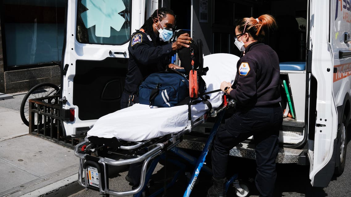 NEW YORK, NY APRIL 01: Ambulance workers clean a gurney at Mount Sinai Hospital amid the coronavirus pandemic on April 01, 2020 in New York City. Hospitals in New York City, the nation's current epicenter of the COVID-19 outbreak, are facing shortages of beds, ventilators and protective equipment for medical staff. Currently, over 75, 000 New Yorkers have tested positive for COVID-19. Spencer Platt/Getty Images/AFP